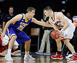SIOUX FALLS, SD: MARCH 6: Lane Severyn #25 of South Dakota State reaches on Matt Mooney #13 of South Dakota  during the Summit League Basketball Championship on March 6, 2017 at the Denny Sanford Premier Center in Sioux Falls, SD. (Photo by Dick Carlson/Inertia)
