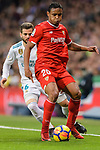 Luis Muriel of Sevilla FC (R) fights for the ball with Nacho Fernandez of Real Madrid (L) during La Liga 2017-18 match between Real Madrid and Sevilla FC at Santiago Bernabeu Stadium on 09 December 2017 in Madrid, Spain. Photo by Diego Souto / Power Sport Images