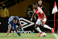 BOGOTA - COLOMBIA, 07-09-2019: Carlos Arboleda del Santa Fe disputa el balón con Jhon Duque Arias de Millonarios durante partido entre Independiente Santa Fe y Millonarios por la fecha 10 de la Liga Águila II 2019 jugado en el estadio Nemesio Camacho El Campín de la ciudad de Bogotá. / Carlos Arboleda of Santa Fe vies for the ball with Jhon Duque Arias of Millonarios during match between Independiente Santa Fe and Millonarios for the date 10 as part of the Aguila League II 2019 played at Nemesio Camacho El Campín stadium in Bogota city. Photo: VizzorImage / Gabriel Aponte / Staff