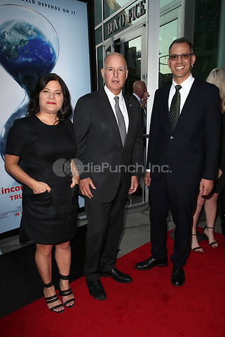 "HOLLYWOOD, CA - JULY 25: Bonni Cohen, Governor Jerry Brown, Jon Shenk, At Screening Of Paramount Pictures' ""An Inconvenient Sequel: Truth To Power"" At ArcLight Hollywood In California on July 25, 2017. Credit: FS/MediaPunch"