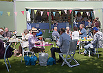 People enjoying afternoon tea during a country fair at Helmingham Hall, Suffolk, England