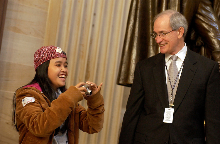 Thuy Anh, a student sponsored by Chief of Staff for Rep. Bart Gordon, D-Tenn., right, takes a picture in the Rotunda during a Capitol tour.