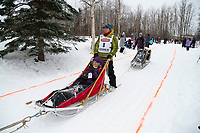 Linwood Fiedler and team run past spectators on the bike/ski trail near University Lake with an Iditarider in the basket and a handler during the Anchorage, Alaska ceremonial start on Saturday, March 7 during the 2020 Iditarod race. Photo © 2020 by Ed Bennett/Bennett Images LLC