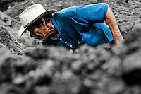 A miner searches for emerald gemstones in the mine of Muzo, Colombia, 20 April 2006. Despite of a persisting civil war conflict and related difficulties Colombia still produces 60 percent of world emerald production. Due to the special clarity and deep vivid green color, gemstones from Muzo are considered the most beautiful emeralds in the world. There have been thousands of treasure hunters coming to Muzo during last decades. They have been searching for a fortune, infatuated by so-callled green fever. The major part of guaqueros (emerald miners) spent long years in the hot and wet unhospitable jungle working hard, they contracted malaria or tropical diseases but they still kept their dream about magic green stone alive.