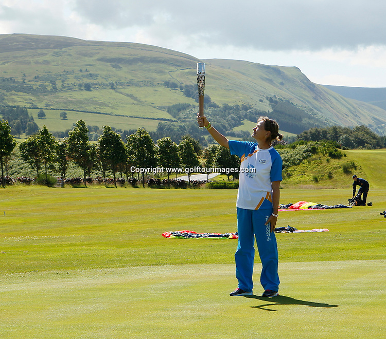Scotland's top lady golfer, Catriona Matthew has the honor of  receiving the Queens Baton  as it arrives by parachute at The Gleneagles Hotel, venue for the 2014 Ryder Cup.The arrival was watched by VIPs and Spectators on a beautiful morning in Perthshire: Picture Stuart Adams www.golftourimages.com: 5th July 2014