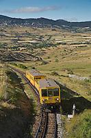 Europe/France/Languedoc-Roussillon/66/Pyrénées-Orientales/Cerdagne/Env de Saillagouse:  Traversant les paturages du plateau cerdan au Col Rigat, le Train jaune de Cerdagne appelé le Train Jaune ou le Canari, car les véhicules arborent les couleurs catalanes, le jaune et le rouge. relie la gare de Villefranche - Vernet-les-Bains à celle de Latour-de-Carol - Enveigt via Font-Romeu en suivant la vallée de la Têt puis en parcourant le plateau de Cerdagne.