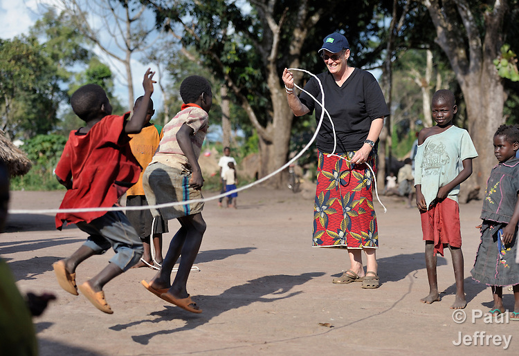Sister Margaret Scott, a New Zealander and member of the Sisters of Our Lady of the Missions, helps children skip rope in the Makpandu refugee camp in Southern Sudan, 44 km north of Yambio, where more that 4,000 people took refuge in late 2008 when the Lord's Resistance Army attacked their communities inside the Democratic Republic of the Congo. Attacks by the LRA inside Southern Sudan and in the neighboring DRC and Central African Republic have displaced tens of thousands of people, and many worry the attacks will increase as the government in Khartoum uses the LRA to destabilize Southern Sudan, where people are scheduled to vote on independence in January 2011. Catholic pastoral workers have accompanied the people of this camp from the beginning. Sister Margaret works in the area as a member of Solidarity with Southern Sudan, a group of Catholic priests, sisters and brothers from around the world who assist the nascent nation's people with education, health, and pastoral ministry. NOTE: In July 2011 Southern Sudan became the independent country of South Sudan.