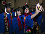 Spanish majors Michael Curry, Reyna Avila and Zuly Moreno (left to right) snap a selfie as students from the DePaul University College of Science and Health and College of Liberal Arts and Social Sciences gather backstage for the 119th commencement ceremonies Sunday, June 11, 2017, at the Allstate Arena in Rosemont, IL. (DePaul University/Jamie Moncrief)