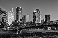 The Sabine promenade pedestrian bridge in black and white in the downtown area with Houston skyline.  Houston is a city of high rise skyscrapers with some of the tallest in Texas and the southern US. The JP Morgan Chase comes in at whopping 1002 feet and the Well Fargo  building in this image comes as the second tallest building in the city at 992 feet  while the Heritage Plaza to the right comes in at 762 ft still a very impressive of the city skycrapers.