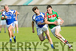 Kilcumin's Kevin McCarthy gets away from KOR's Danny O'Sullivan in the Credit Union County Senior Football League Div. 1 Kerins O'Rahilys Vs Kilcummin at Strand Road GAA Ground on Friday