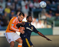 Houston Dynamo's (17) Mike Chabala and Los Angeles Galaxy's (14) Edson Buddle battle for a ball in the first half at the Home Depot Center in Carson, CA on Sunday, June 28, 2009..