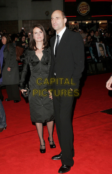 "MARK STRONG & GUEST .UK Premiere of ""Body of Lies"" at the Vue West End, Leicester Square, London, England, November 6th 2008..full length black tie suit .CAP/AH.©Adam Houghton/Capital Pictures"