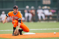 Oklahoma State Cowboys shortstop Donnie Walton #5 waits for the catchers throw at second base during steal attempt in the NCAA baseball game against the Texas Longhorns on April 26, 2014 at UFCU Disch–Falk Field in Austin, Texas. The Cowboys defeated the Longhorns 2-1. (Andrew Woolley/Four Seam Images)