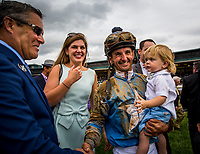 LEXINGTON, KY - OCTOBER 07: Jockey Robby Albarado with his son Liam, and wife Paige after winning the Claiborne Breeders' Futurity  at Keeneland Race Course on October 07, 2017 in Lexington, Kentucky. (Photo by Alex Evers/Eclipse Sportswire/Getty Images)