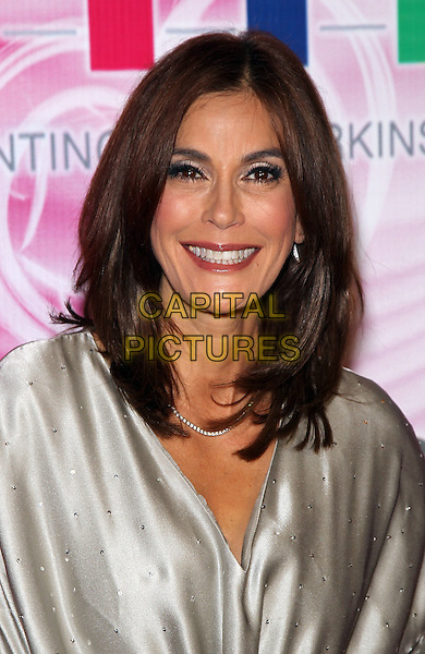 TERI HATCHER .The 15th Annual Keep Memory Alive's Power of Love Gala to benefit Cleveland Clinic Lou Ruvo Center at the Bellagio Resort Hotel and Casino,  Las Vegas, Nevada, USA, 26th February 2011..portrait headshot smiling grey gray silver silk satin studded make-up eyeshadow .CAP/ADM/MJT.© MJT/AdMedia/Capital Pictures.