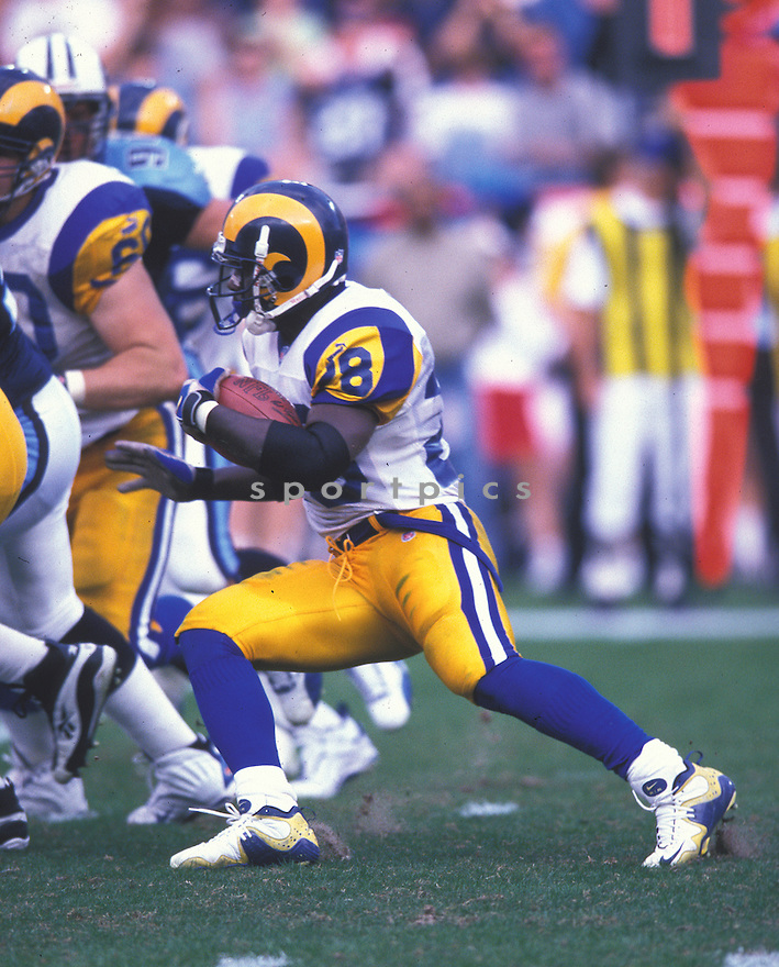 St. Louis Rams, Marshall Faulk (28)  during a game against the Tennessee Titans on October 31, 1999 at Adelphia Coliseum in Nashville, Tennessee.  The Titans beat the Rams 24-21. Marshall Faulk played for 12 years with 2 different teams, was a 7-time Pro Bowler and was inducted to the Pro Football Hall of Fame in 2011.