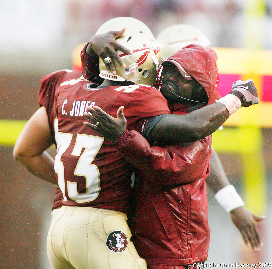 TALLAHASSEE, FL 9/12/09-FSU-JSUFB09 CH12-Florida State's Ty Jones gets a hug from Running Backs Coach Dexter Carter after scoring his first touchdown against Jacksonville State during first half action Saturday at Doak Campbell Stadium in Tallahassee. .COLIN HACKLEY PHOTO