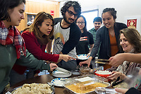 People get Lunar New Year treats from various Asian countries to try at a Lunar New Year celebration at Middlesex Community College's Asian American Connections Center on Thus., Feb. 15, 2018. The Asian American Connections Center was established at the school using a federal grant in 2016 and serves as a focal point for the Asian community at the school, predominantly Cambodian, to gather, socialize, study, and otherwise take part in student life. Bopha Malone, a Trustee of the College, (second from left in red), Cherry Lim, Specialist for Asian American Student Advancement Program (second from right in orange dress with gray top), and Pam Flaherty, Dean of Students and Senior Student Affairs Officer (seated at right), joined in the celebration.