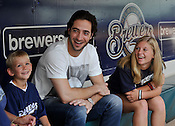 Client: Limelite Fusion Energy Drink<br /> Milwaukee Brewers star Ryan Braun chats with Limelite Fusion contest winners TJ and Kayla Williams, 7 and 13, at Miller Park in Milwaukee on Friday, Aug. 12, 2011. Ernie Mastroianni photo.