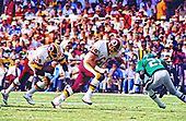 Washington Redskins running back George Rogers (38) follows the lead block from left offensive tackle Joe Jacoby (66) during the game against the Philadelphia Eagles at RFK Stadium in Washington, DC  on September 7, 1986.  The Redskins won the game 41 - 14.  Eagles right cornerback Evan Cooper (21) tries to defend on the play.<br /> Credit: Arnie Sachs / CNP