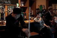 A young Chinese man drinks at a pub in Shanghai, China on November 06, 2009.