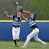 John LaRocca #31, St. Dominic centerfielder, left, and Justin Rodriguez #32, right fielder, narrowly avoid colliding in the top of the fifth inning of a CHSAA varsity baseball game against Holy Trinity at Charles Wang Athletic Complex in Muttontown on Friday, Apr. 22, 2016. LaRocca hung on to make the catch. St. Dominic won by a score of 4-0.