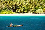 A woman paddling in her canoe between islandsBoboeina Island in the Louisiade Archipelago..The Louisiade Archipelago is a string of ten larger volcanic islands frequently fringed by coral reefs, and 90 smaller coral islands located 200 km southeast of New Guinea, stretching over more than 160 km and spread over an ocean area of 26,000 km  between the Solomon Sea to the north and the Coral Sea to the south. The aggregate land area of the islands is about 1,790 kmu178  (690 square miles), with Vanatinai (formerly Sudest or Tagula as named by European claimants on Western maps) being the largest..Sideia Island and Basilaki Island lie closest to New Guinea, while Misima, Vanatinai, and Rossel islands lie further east..The archipelago is divided into the Local Level Government (LLG) areas Louisiade Rural (western part, with Misima), and Yaleyamba (western part, with Rossell and Tagula islands. The LLG areas are part of Samarai-Murua District district of Milne Bay. The seat of the Louisiade Rural LLG is Bwagaoia on Misima Island, the population center of the archipelago. .The Louisiade Archipalego is part of the Milne Bay province of Papua New Guinea..It lies between approximately 10 degrees south and 11.5 degrees south, and 151 degrees east and 154 degrees east. It is an area of Islands, reefs and cays some 200 nm long and 50 nm wide, stretching from the south east tip of mainland Papua New Guinea in a east south east direction..