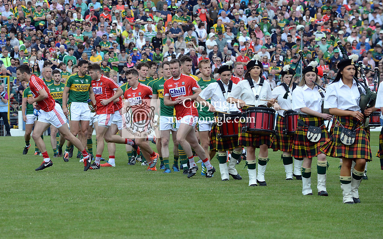 2-7-2017: Cork players break through Kerry players during the parade at the Kerry V Cork Munster Football final in Killarney on Sunday.<br /> Photo: Don MacMonagle