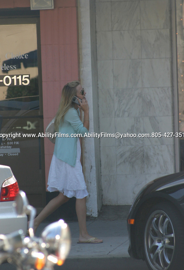 Reese Withersppon Laughing and talking on the phone in beverly hills.Exclusive