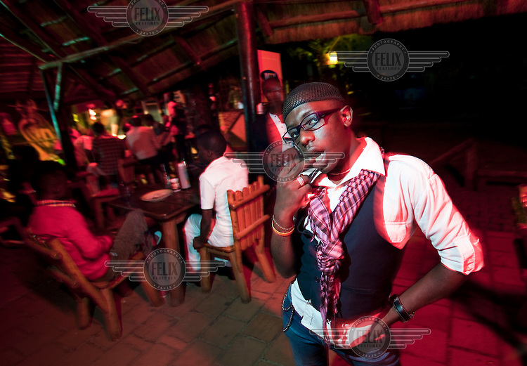 Michael, a professional dancer, during a night out at a gay bar in Kampala.  Parts of the Ugandan church and media have been campaigning against homosexuals and lesbians.