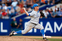 David Berg #26 of the UCLA Bruins pitches against the Cal State Fullerton Titans during the NCAA Super Regional at Goodwin Field on June 7, 2013 in Fullerton, California. UCLA defeated Cal State Fullerton, 5-3. (Larry Goren/Four Seam Images)