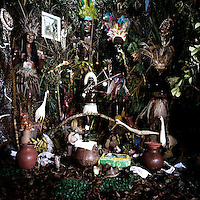 An altar made to honour the orixa (god) of the branch, or nation (nacoe), of Candomble known as Candomble do Caboclo. The term Caboclo, aside from being a term to describe a person of mixed Brazilian Amerindian and European descent, is also used as an alternate term for certain orixas (gods) of the Candomble religion.