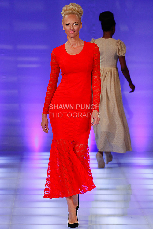Model walks runway in an outfit from the Armina Sark collection, during Couture Fashion Week in New York, September 8, 2013.