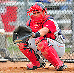 24 July 2010: Lowell Spinners catcher Jayson Hernandez warms his pitcher up prior to a game against the Vermont Lake Monsters at Centennial Field in Burlington, Vermont. The Spinners defeated the Lake Monsters 11-5 in NY Penn League action. Mandatory Credit: Ed Wolfstein Photo