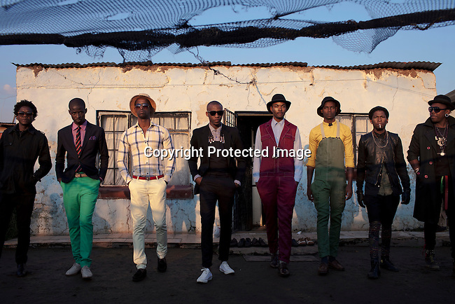 SOWETO, SOUTH AFRICA MAY 21: Sibu Sithole (r), a young designer part of the group Smarteez with his models and his colleagues on May 21, 2013 in Kliptown section of Soweto, South Africa. They did a photo shoot together with a new collection. Soweto today is a mix of old housing and newly constructed townhouses. A new hungry black middle-class is growing steadily. Many residents work in Johannesburg but the last years many shopping malls have been built, and people are starting to spend their money in Soweto. (Photo by: Per-Anders Pettersson)