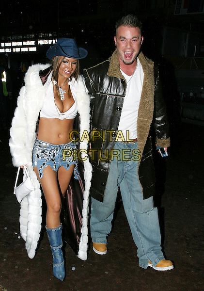 JODIE MARSH & FRAN COSGROVE.Leaving Cinema After Premiere of Gumball 3000: The Movie.denim skirt, denim boots, long white fur coat, belly, midriff, full length, full-length.www.capitalpictures.com.sales@capitalpictures.com.© Capital Pictures.