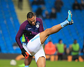 9th January 2018, Etihad Stadium, Manchester, England; Carabao Cup football, semi-final, 1st leg, Manchester City versus Bristol City; Danilo of Manchester City does his pre-game stretching
