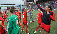 Portland, Oregon - Sunday September 4, 2016: Portland Thorns FC forward Nadia Nadim (9) and Portland Thorns FC forward Christine Sinclair (12) high five during a regular season National Women's Soccer League (NWSL) match at Providence Park.
