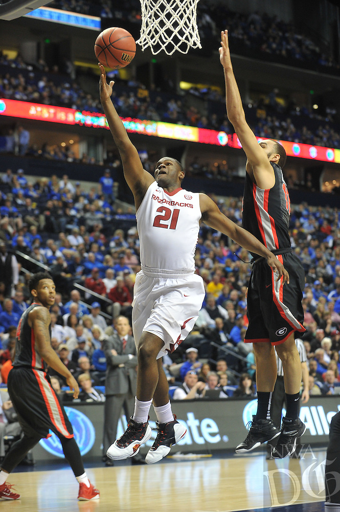 NWA Democrat-Gazette/Michael Woods --03/14/2015--w@NWAMICHAELW... University of Arkansasguard Manuael Watkins drives to the hoop to score on a lay up in the first half of the Razorbacks 60-49 win in Saturdays game against the Georgia Bulldogs at the 2015 SEC basketball tournament at Bridgestone Arena in Nashville.