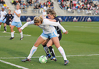 Chicago Red Stars defender Marian Dalmy (2) works hard to defend against Washington Freed midfielder Sonia Bompastor (8).   Chicago Red Stars tied Washington Freedom  1-1 at The Maryland SoccerPlex, Saturday April 11, 2009.