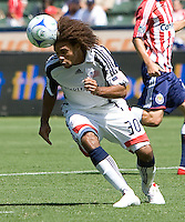 New England Revolution midfielder Kevin Alston puts his head on a ball. Chivas USA defeated the New England Revolution 2-0 at Home Depot Center stadium in Carson, California on Sunday September 13, 2009...