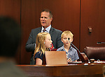 Nevada Lt. Gov. Mark Hutchison says the Pledge of Allegiance with Julianne and Jack Delap on the Senate floor at the Legislative Building in Carson City, Nev., on Thursday, May 7, 2015.<br /> Photo by Cathleen Allison