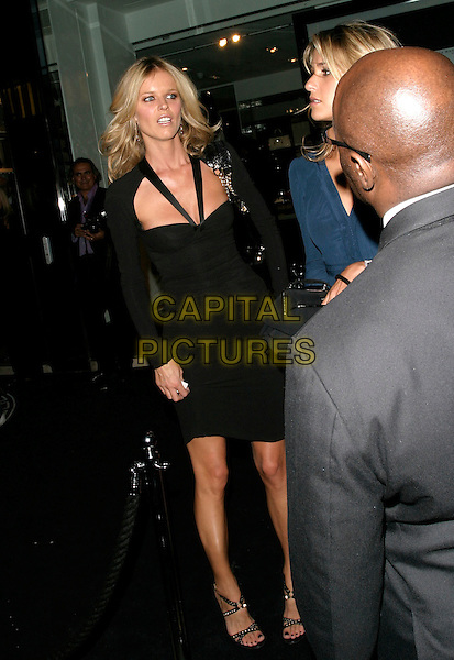 EVA HERZIGOVA.Leaving afterparty for the launch party for the 21st anniversary issue of Elle Magazine at the Versace Store in Sloane Street, London, UK..September 7th, 2006.Ref: AH.full length black dress.www.capitalpictures.com.sales@capitalpictures.com.©Adam Houghton/Capital Pictures.