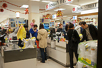 """Customers endure long lines because of Hurricane Sandy in a Gristede's supermarket in the Chelsea neighborhood of New York on Sunday, October 28, 2012. In advance of the arrival of Hurricane Sandy New York will down the subways at 7 PM on Sunday and evacuate low lying """"Zone A"""" areas including Battery Park City. In addition the schools will be closed on Monday. (© Richard B. Levine)"""