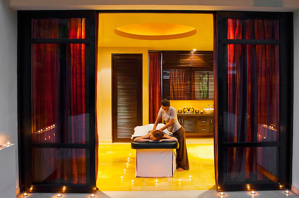 Woman receives massage at dusk, Visaya Spa, FCC Angkor, Siem reap, Cambodia.