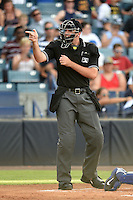 Umpire Nathan Thompson makes a call during a game between the Dunedin Blue Jays and Tampa Yankees on June 28, 2014 at George M. Steinbrenner Field in Tampa, Florida.  Tampa defeated Dunedin 5-2.  (Mike Janes/Four Seam Images)