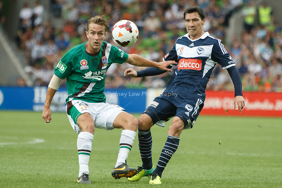 Chilean player Pablo CONTRERAS of the Victory kicks the ball in the round nine match between Melbourne Victory and the Newcastle Jets in the Australian Hyundai A-League 2013-24 season at AAMI Park, Melbourne, Australia. Photo Sydney Low/Zumapress<br /> <br /> This image is not for sale on this web site. Please visit zumapress.com for licensing