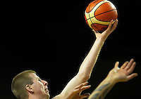 Boomers forward Brock Motum lays a shot up during the FIBA Oceania men's tournament basketball match between New Zealand and Australia at TSB Bank Arena, Wellington, New Zealand on Tuesday, 18 August 2015. Photo: Dave Lintott / lintottphoto.co.nz