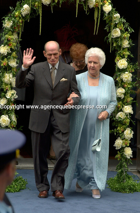 Singer Celine Dion parents exit the Notre Dame Basilica after their grand  son ;   Rene Charles baptism, July 25th 2001 in Montreal, CANADA.<br /> Photo by Pierre Roussel / I Photo.ca