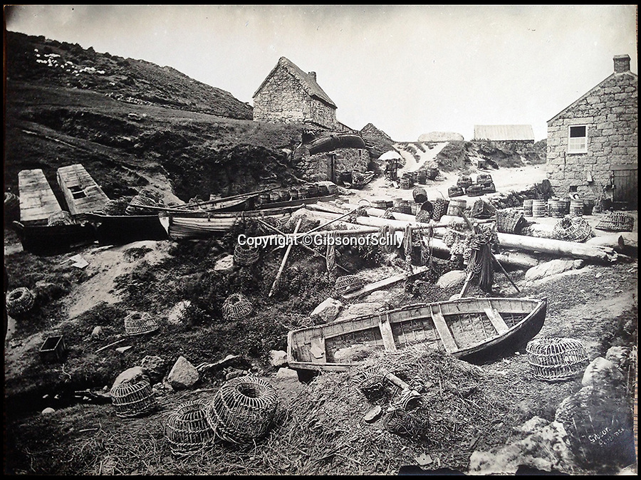 BNPS.co.uk (01202 558833)<br /> Pic: GibsonOfScilly/BNPS<br /> <br /> Remote Cornish fishing village Porthgwarra..<br /> <br /> An archive of eye-opening photographs documenting the grim reality of Poldark's Cornwall has emerged for sale for &pound;25,000.<br /> <br /> More than 1,500 black and white images show the gritty lives lived by poverty-stricken families in late 19th and early 20th century Cornwall - around the same time that Winston Graham's famous Poldark novels were set.<br /> <br /> The collection reveals the lowly beginnings of towns like Rock, Fowey, Newquay and St Ives long before they became picture-postcard tourist hotspots.<br /> <br /> Images show young filth-covered children playing barefoot in squalid streets, impoverished families standing around outside the local tax office, and weather-beaten fishwives tending to the day's catch.<br /> <br /> The Cornish archive, comprising 1,200 original photographic prints and 300 glass negative plates, is tipped to fetch &pound;25,000 when it goes under the hammer as one lot at Penzance Auction House.